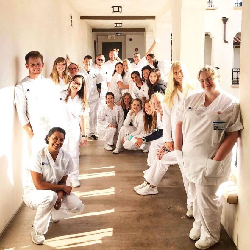 The 24 students in Vanguard University's nursing pre-licensure program, which started in 2018, will be the very first graduating class. Andrew Bailey, in the back under the Exit sign, says graduating without a physical commencement ceremony is bittersweet.