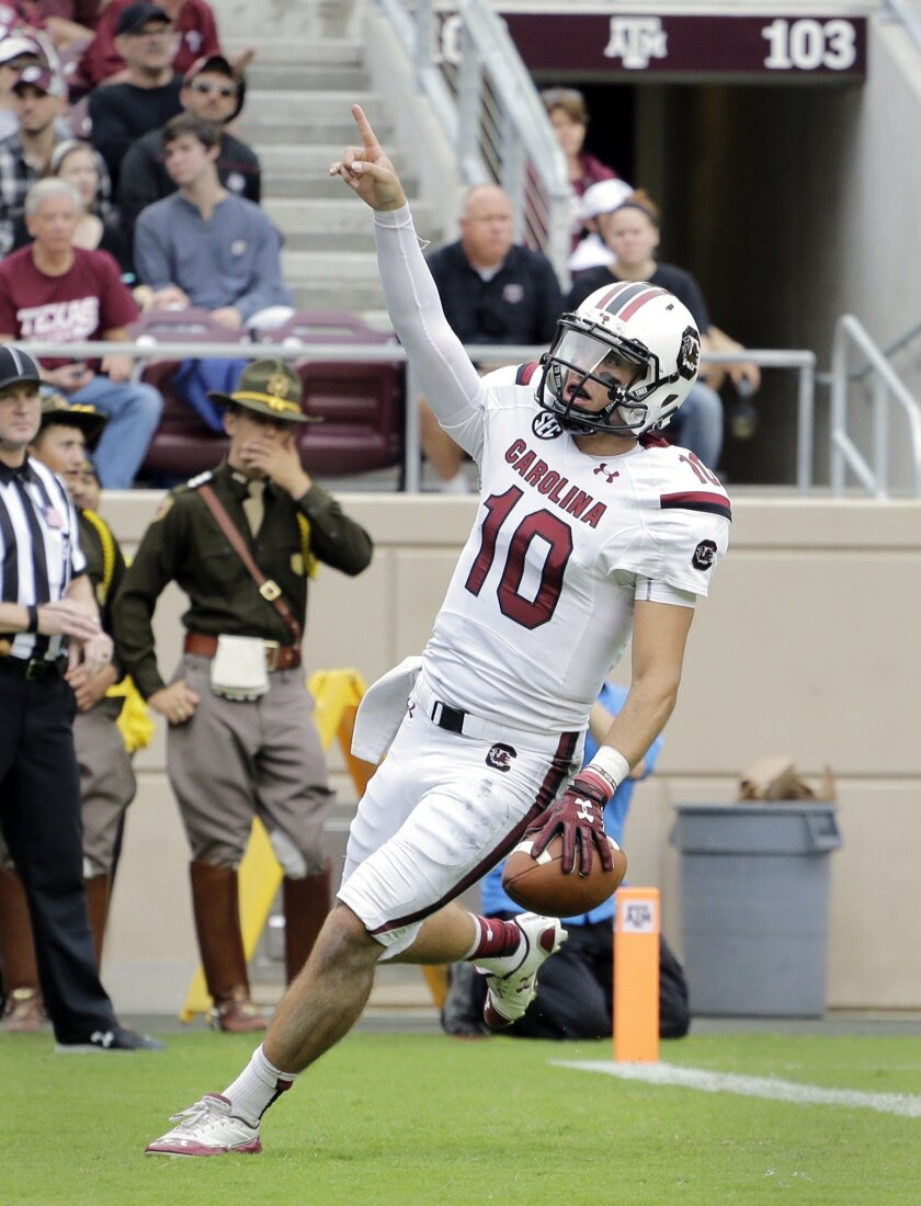 South Carolina quarterback Perry Orth (10) celebrates as he scores a touchdown against Texas A&M during the first half of an NCAA college football game, Saturday, Oct. 31, 2015, in College Station, Texas. (AP Photo/Eric Gay)