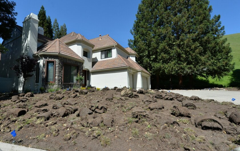 A lawn is removed as landscaping work is being done at a home in Blackhawk, Calif., on Friday, April 15, 2016.