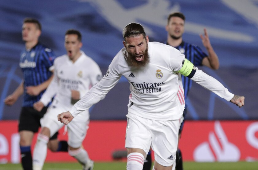 Real Madrid's Sergio Ramos celebrates scoring his side's 2nd goal during the Champions League, round of 16, second leg soccer match between Atalanta and Real Madrid at the Alfredo di Stefano stadium in Madrid, Spain, Tuesday, March 16, 2021. (AP Photo/Bernat Armangue)