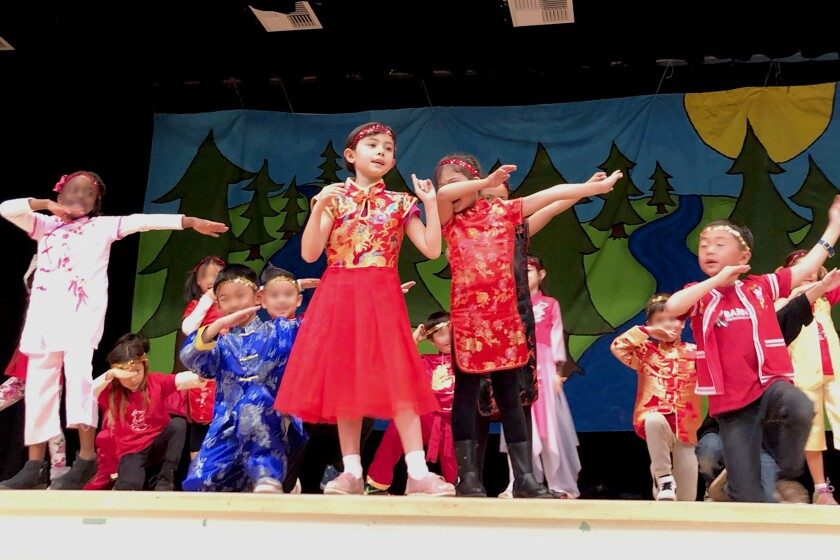 First-grader Natalie M. (center) performs with her classmates during Barnard Mandarin Magnet Elementary School's Chinese New Year celebration held earlier in the year, before all area schools closed due to coronavirus concerns.