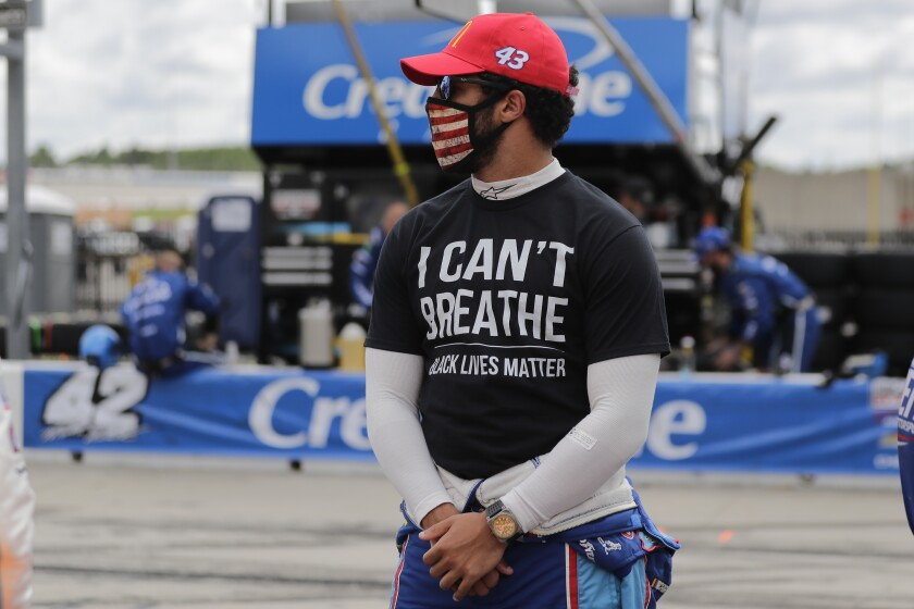 "NASCAR driver Bubba Wallace wears a ""I Can't Breath, Black Lives Matter"" shirt."