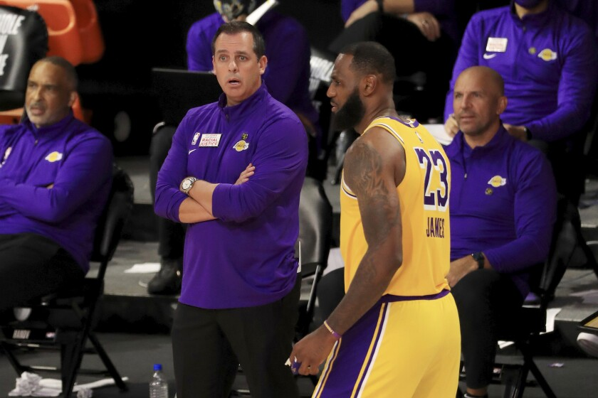Coach Frank Vogel, center, and the rest of the Lakers traveling party had a pizza feed after advancing in the playoffs.