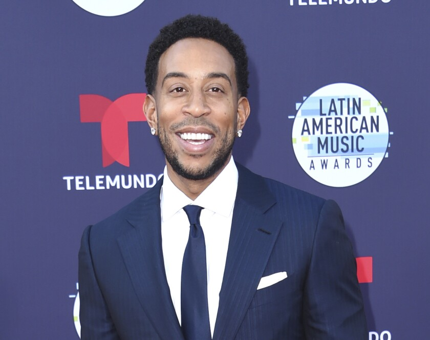"""FILE - Ludacris arrives at the Latin American Music Awards in Los Angeles on Oct. 25, 2018. The rapper-actor stars in """"Luda Can't Cook,"""" a one-hour special that debuts Feb. 25 on the discovery+ plus streaming service. He gets schooled by chef Meherwan Irani, who introduces him to international flavors and techniques. (Photo by Richard Shotwell/Invision/AP, File)"""
