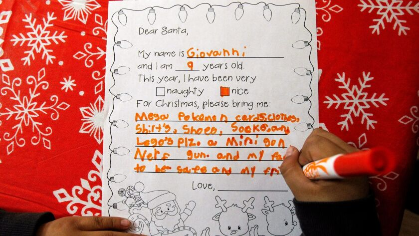 ESCONDIDO, December 5, 2017   Giovanni Alonzo, 9, writes down his wishes for Christmas during the L