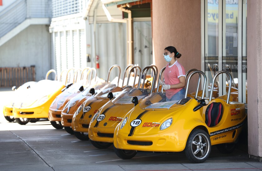 A worker waits for customers at GoCar Tours in San Francisco.