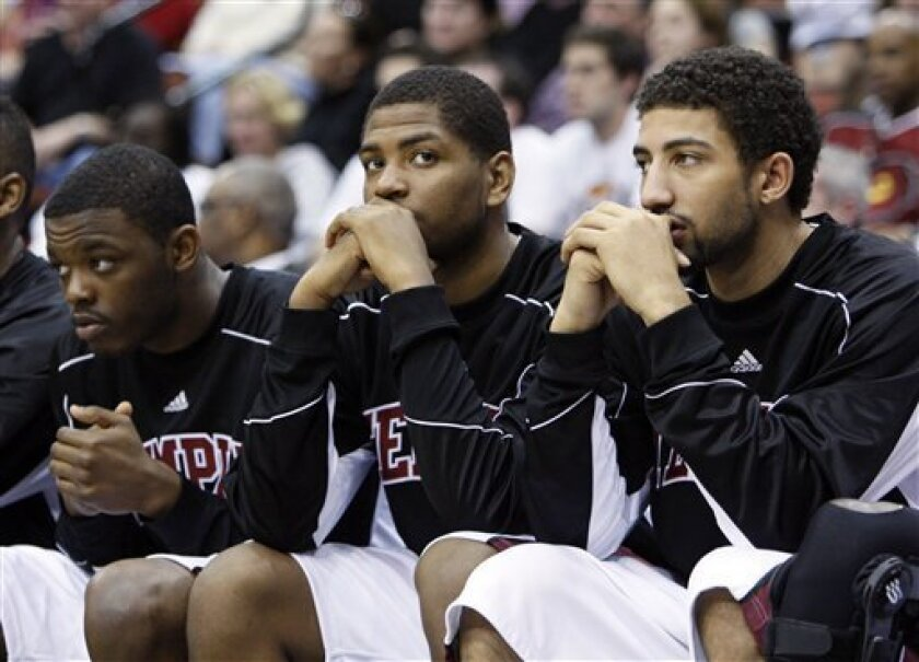 Temple players, from left, Scootie Randall, Khalif Wyatt and Rafael DeLeon look on from the bench ss their team falls behind Cornell late in the first half of an NCAA first-round college basketball game in Jacksonville, Fla., Friday, March 19, 2010.  (AP Photo/Wilfredo Lee)