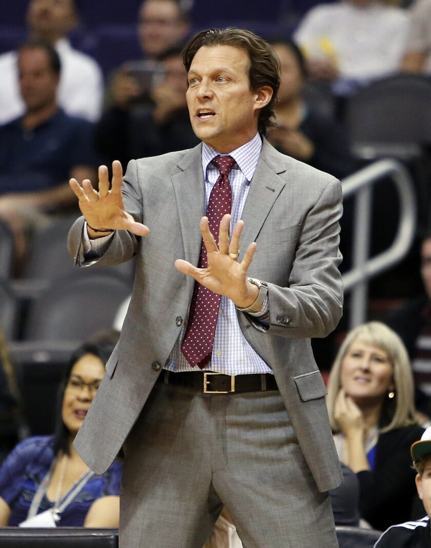 Utah Jazz head coach Quin Snyder reacts to a foul call in the second quarter during an NBA basketball game against the Phoenix Suns, Saturday, Feb. 6, 2016, in Phoenix. (AP Photo/Rick Scuteri)