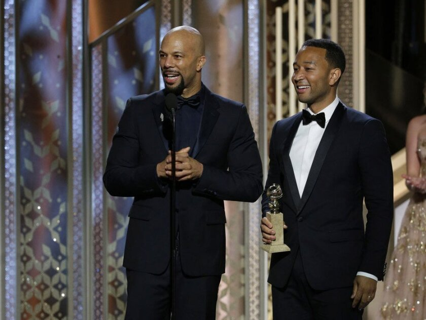 "Common, left, and John Legend accept the Golden Globe for original song for their ""Glory,"" from ""Selma."""