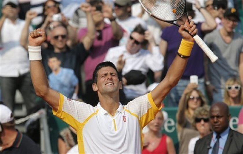 Novak Djokovic of Serbia reacts after defeating Mikhail Youzhny of Russia in their match of the Monte Carlo Tennis Masters tournament in Monaco, Wednesday, April 17, 2013. (AP Photo/Lionel Cironneau)