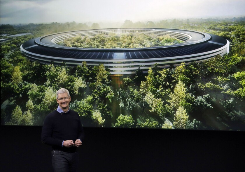Apple CEO Tim Cook, discusses the new Apple campus at an event to announce new products at Apple headquarters Monday, March 21, 2016, in Cupertino, Calif. The tech giant said it will build a second campus, the location of which will be revealed later in 2018.