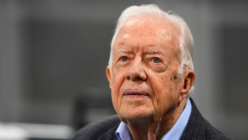 President Carter falls, breaks hip