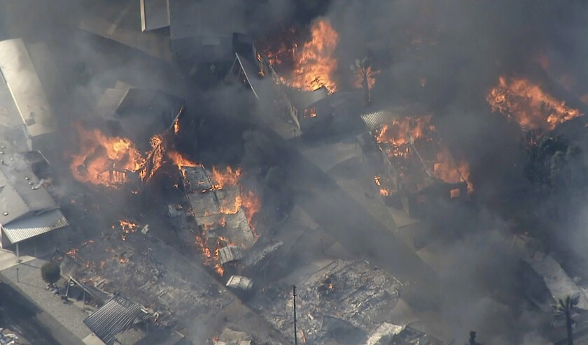 Mobile homes go up in flames in Calimesa on Thursday afternoon.