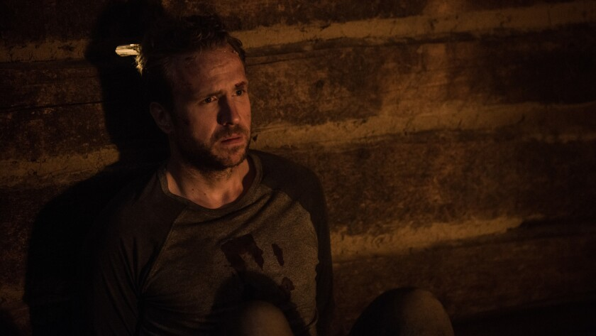 """Rafe Spall in the movie """"The Ritual"""" portrays a man tormented by grief over a friend's slaying at the same time as he is being stalked by a mysterious creature."""