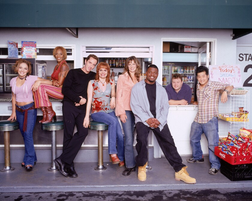 """The 2002 cast of """"MADtv"""" included Jill-Michele Melean, left, Debra Wilson, Michael McDonald, Stephnie Weir, Mo Collins, Aries Spears, Frank Caliendo and Bobby Lee. Some former cast members will appear on the new show coming to the CW."""