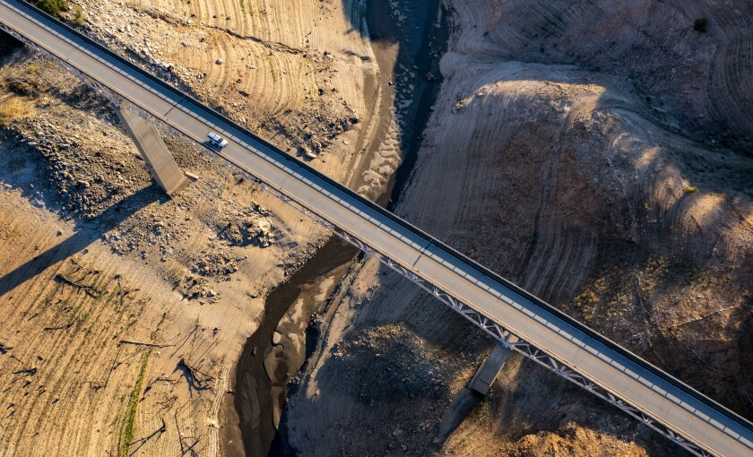 A truck crosses the Enterprise Bridge at Lake Oroville, which is 33% full