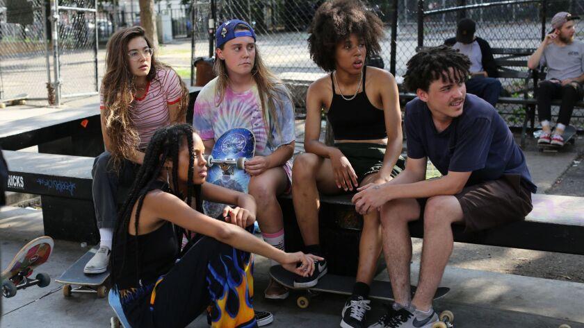 "Rachelle Vinberg, left, Ajani Russell, Nina Moran, Dede Lovelace and Alexander Cooper in ""Skate Kitchen."""