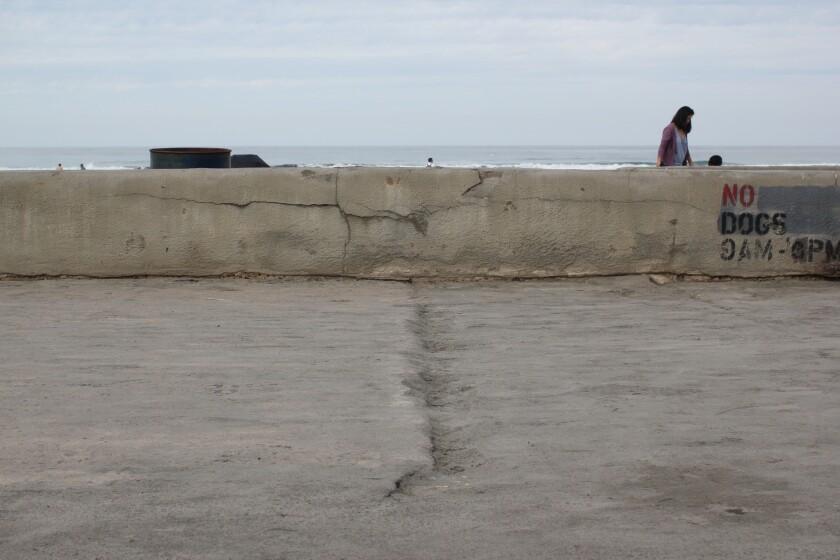 Jagged seawall cracks and menacing sidewalk gaps
