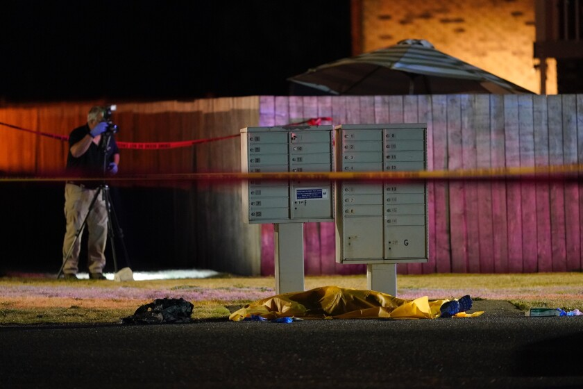 Officials at a scene where a man suspected of fatally shooting a supporter of a right-wing group in Portland was killed.