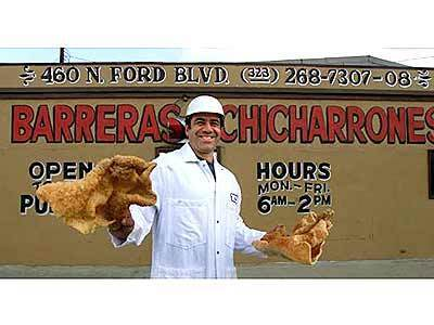 Mike Barreras, a fourth-generation chicharrón maker, shows off his wares.