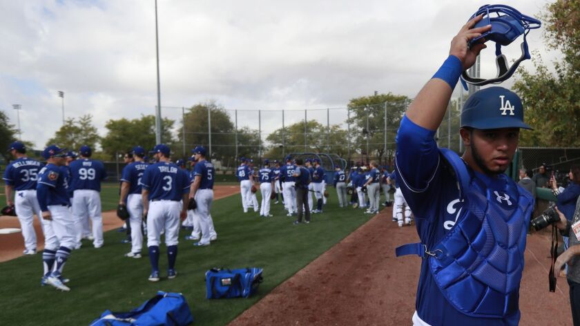 Dodgers non-roster invitee Keibert Ruiz heads to the practice field at the team's spring training facility in Phoenix on Monday.