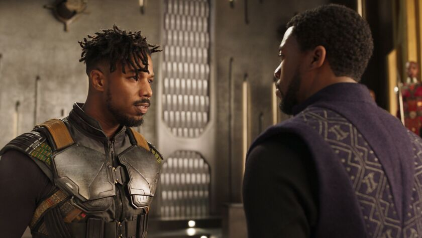 L to R: Erik Killmonger (Michael B. Jordan) and T'Challa/Black Panther (Chadwick Boseman) in Marvel