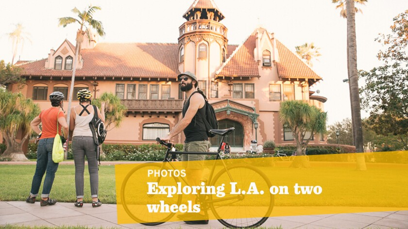 """Los Angeles Explorers Club, founded by Aimee Gilchrist and Brantlea Newbery, has staged six different themed """"bicycle journeys into forgotten times"""" over the last two years. Here, a group of riders visits the Mount Saint Mary's University campus."""