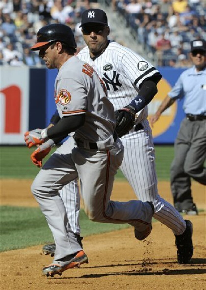 New York Yankees shortstop Derek Jeter, right, tags out Baltimore Orioles' Brian Roberts during the seventh inning of a baseball game Monday, Sept. 6, 2010 at Yankee Stadium in New York. Roberts hit a RBI single but was caught in a rundown between first and second. The Orioles won 4-3. (AP Photo/Bill Kostroun)