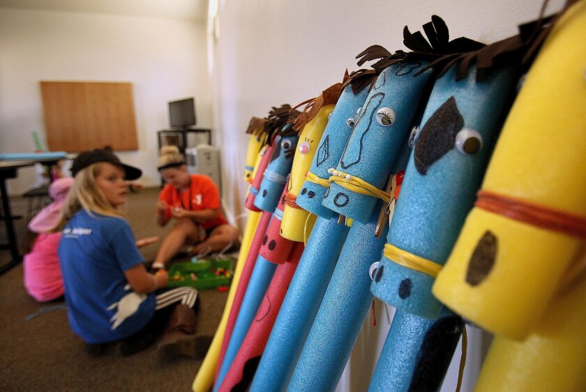 One of the projects in YMCA summer camp at Blue Apple Ranch was to make rideable toy horses out of swimming noodle floats.
