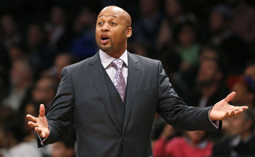 Then-Denver Nuggets coach Brian Shaw gestures during a game against the Brooklyn Nets on Dec. 23, 2014.