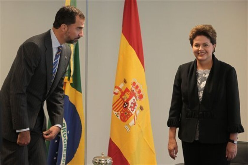 Brazil's President Dilma Rousseff, right, looks on as Spain's Prince Felipe prepares to sit during a meeting at the Planalto presidential palace in Brasilia, Brazil, Sunday, Jan. 2, 2011. Rousseff, a former rebel who was imprisoned and tortured during the nation's 21-year military dictatorship, was sworn in as Brazil's first female president Saturday. (AP Photo/Eraldo Peres)