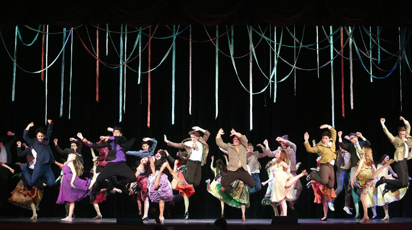 Student actors perform in a dress rehearsal for West Side Story at Burroughs High School on Tuesday,