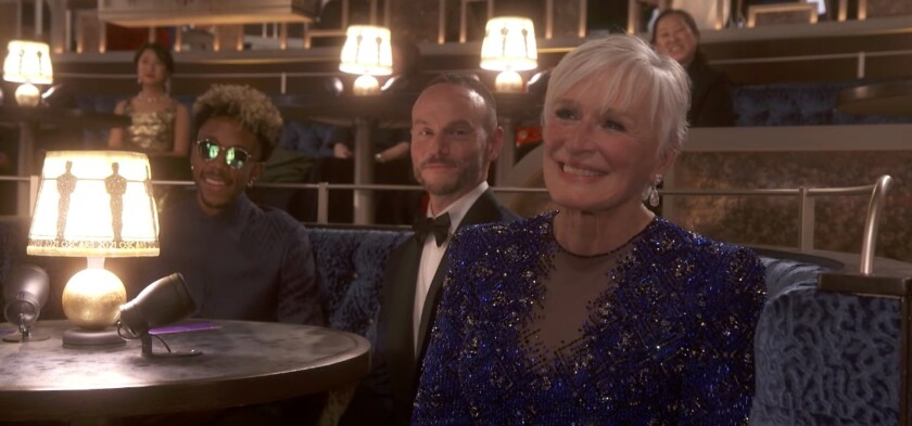 Glenn Close smiling in a sparkly purple dress