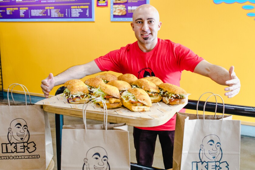 """Ike Shehadeh, the founder of Ike's Love & Sandwiches and face behind the brand's """"Sandwich Wizard"""" logo."""