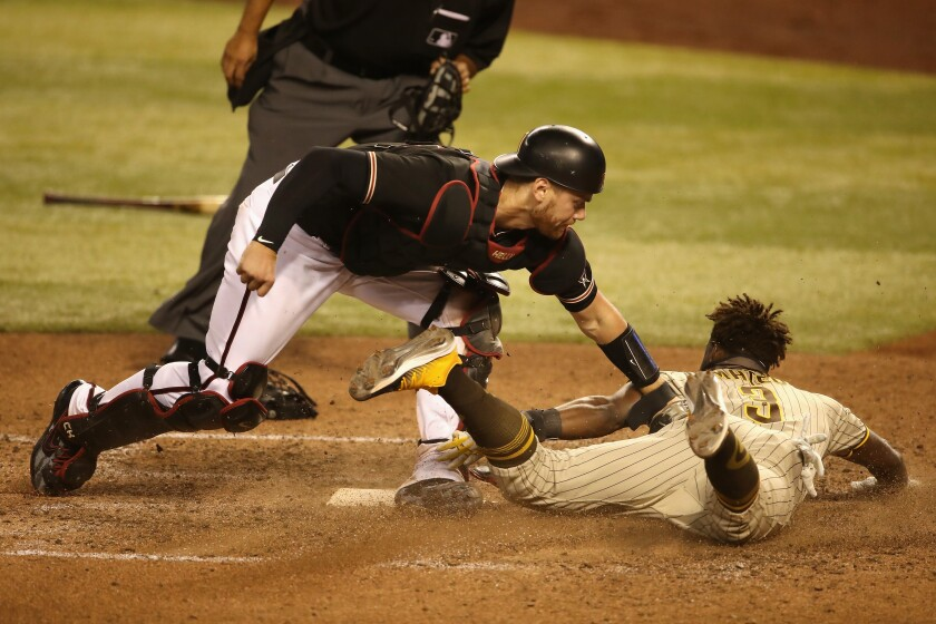 Catcher Carson Kelly of the Arizona Diamondbacks tags out Jorge Mateo of the Padres to end Saturday's game at Chase Field.