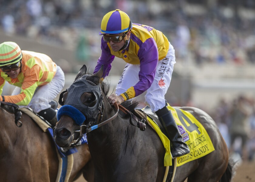 In this image provided by Benoit Photo, Ollie's Candy, right, with Kent Desormeaux aboard, wins the Grade I $300,000 Clement L. Hirsch Stakes horse race Sunday, July 28, 2019, at the Del Mar Thoroughbred Club in Del Mar, Calif. (Benoit Photo via AP)