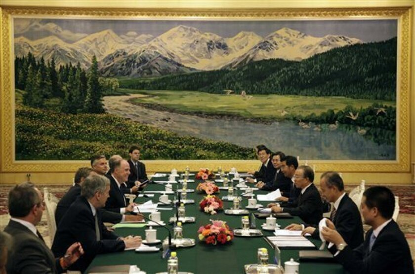 U.S. Deputy National Security Adviser Tom Donilon, fourth from left, reacts during a meeting with Chinese State Councilor Dai Bingguo, third from right, during a meeting at the Great Hall of the People in Beijing Tuesday, Sept. 7, 2010. (AP Photo/Ng Han Guan, Pool)