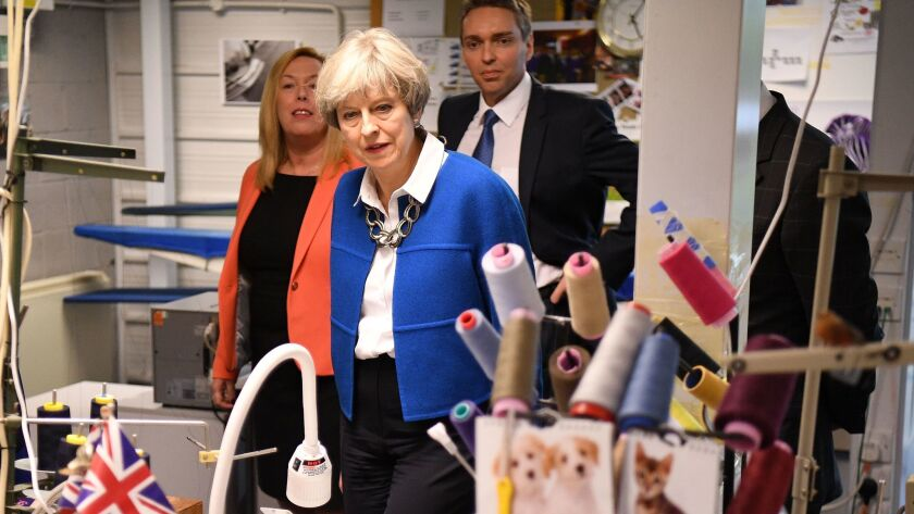 British Prime Minister Theresa May visits Simon Jersey, a business uniform supplier in the Constituency of Hyndburn on May 30, 2017, in Accrington, England. Britain goes to the polls on June 8 to elect a new Parliament in a general election.