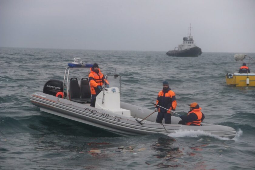 A photo made available by the Russian Ministry of Emergencies shows rescue boats on Sunday searching in the Black Sea near the coastline of Sochi for wreckage of a Russian Tu-154 plane.