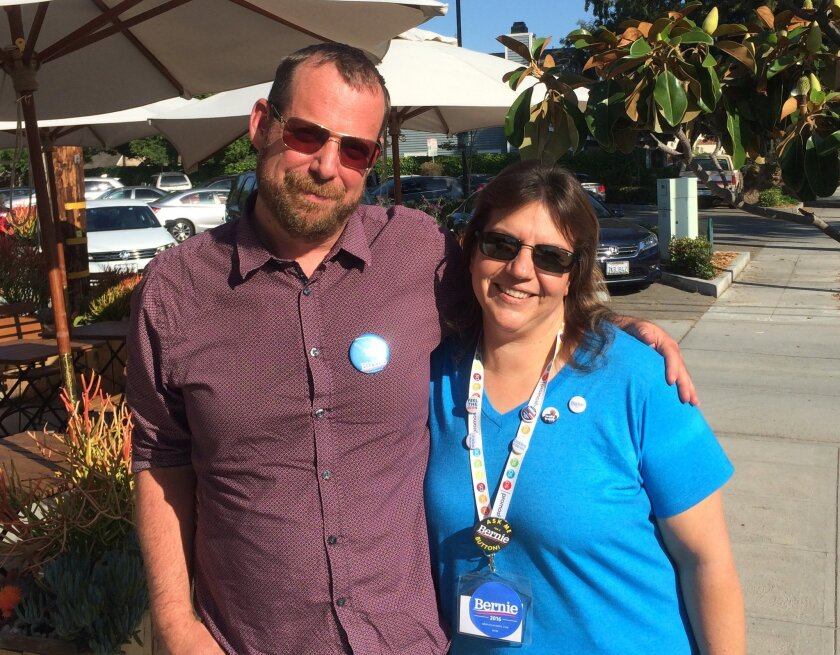In this photo taken May 27, 2016, Bernie Sanders organizer Mary Kellerman, 41, poses outside a Burbank, Calif. coffee shop where she met with fellow campaign volunteer Buddy Totten, 45. Sanders and Hillary Clinton are in a tough race for delegates in the nation's most populous state, and the candid