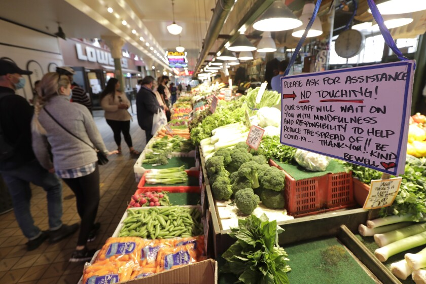 """A sign at a produce stand reads """"No Touching!"""" at Pike Place Market in Seattle."""