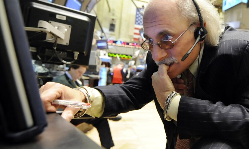 A trader works on the floor of the New York Stock Exchange in 2009, during the Great Recession.