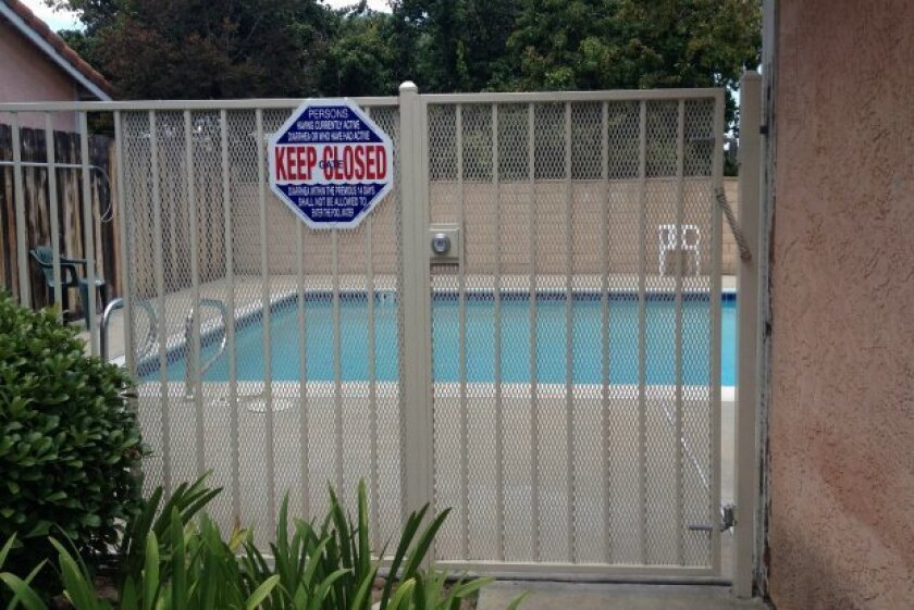 On March 27, an inspector closed the Mesa Knolls pool in La Mesa after finding a new gate with a deadbolt lock, instead of self-latching and self-closing mechanisms. He also noted black algae growth on the west end of the pool. The gate was still not properly latched during a second inspection on A