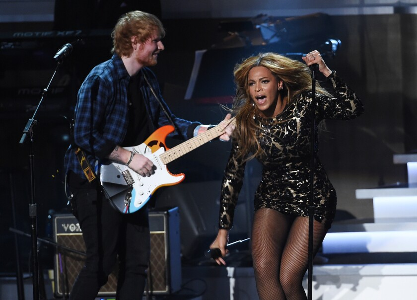 """Ed Sheeran and Beyonce perform Tuesday night during """"Songs in the Key of Life: An All-Star Grammy Salute,"""" a tribute to Stevie Wonder, at the Nokia Theatre."""