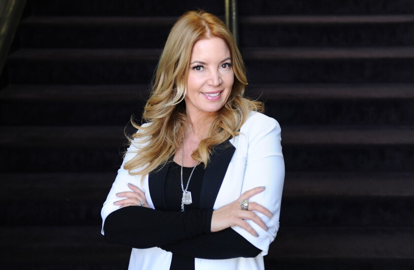 Lakers President Jeanie Buss defends Kobe Bryant after a report cites anonymous agents saying NBA players don't want to play with the Lakers' star.