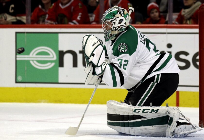 Dallas Stars goalie Kari Lehtonen saves a shot during the second period of an NHL hockey game against the Chicago Blackhawks Thursday, Feb. 11, 2016, in Chicago. (AP Photo/Nam Y. Huh)