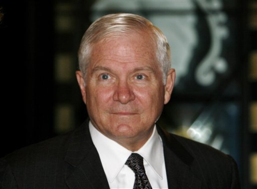 U.S. Defense Secretary Robert Gates arrives at the Ritz-Carlton Hotel and Spa in Manama, Bahrain, where the International Institute for Strategic Studies is opening a regional security summit, Friday, Dec. 12, 2008. Gates met briefly with other senior officials participating in the Manama Dialogue, where Gulf Arab states' concerns about Persian Iran as well as piracy and maritime security are expected to be among concerns addressed. (AP Photo/Hasan Jamali)