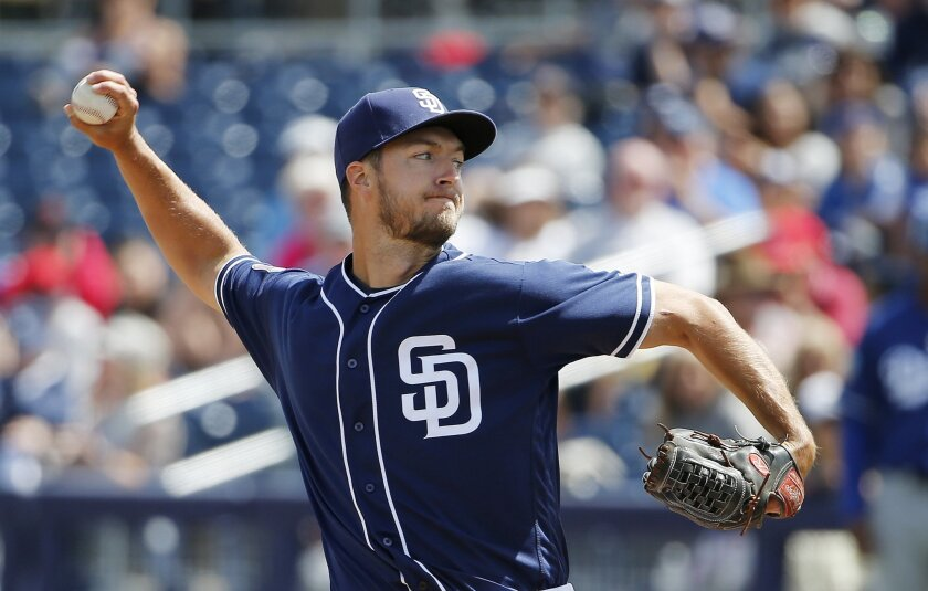 San Diego Padres' Colin Rea throws a pitch against the Los Angeles Dodgers during the first inning of a spring training baseball game Tuesday, March 29, 2016, in Peoria, Ariz. (AP Photo/Ross D. Franklin)