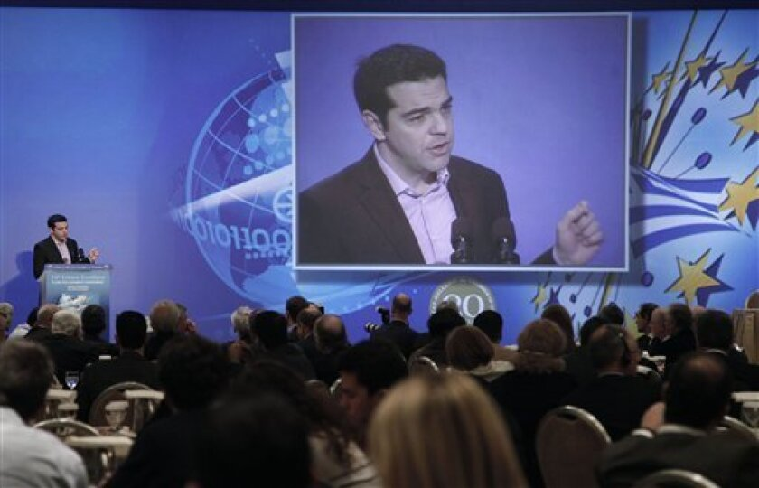 Greek left-wing opposition leader Alexis Tsipras speaks about the Greek economy at the annual conference of the American-Hellenic Chamber of Commerce in Athens, on Tuesday, Dec. 4, 2012. Greece is planning to spend up to €10 billion ($13 billion) in a bond buyback program that it hopes will help bring its debt under control. (AP Photo/Petros Giannakouris)