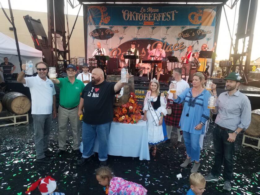 La Mesa Mayor Mark Arapostathis (in the I Love La Mesa t-shirt) and others celebrate 2018 Oktoberfest in La Mesa.